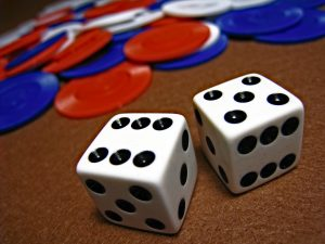 Pair of dice in front of poker chips.